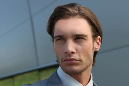 slick: Head shot of a suave young executive Stock Photo