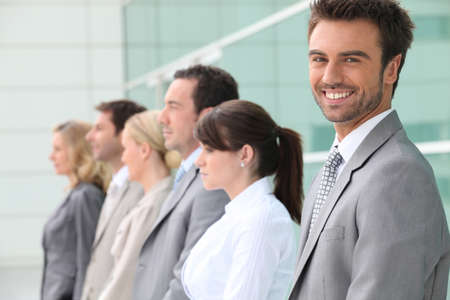 collaborators: businessman smiling with team