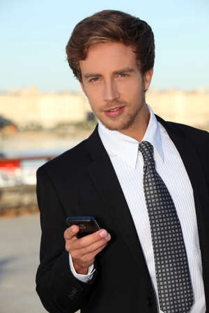 Young man with a mobile phone photo