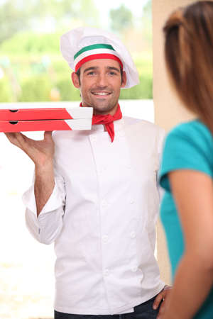 fast delivery: Pizza delivery man