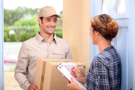 mail man: Courier delivering a parcel