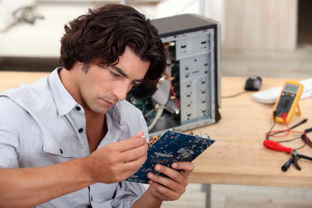 man repairing pc photo