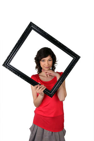 Woman with black frame in hand photo
