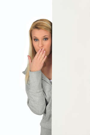 Woman with her hand over her mouth photo