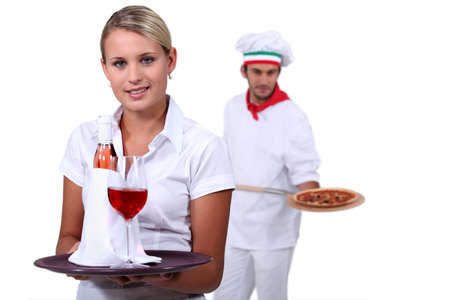 hospitality industry: Young people working in a restaurant Stock Photo