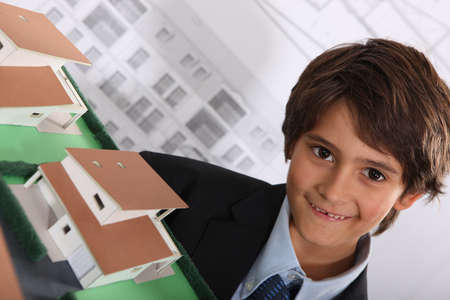 7 8 years: Little boy architect in office