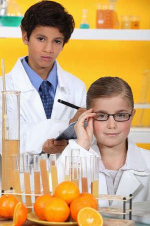 Children analysing orange juice photo