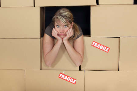 Bored woman surrounded by boxes photo
