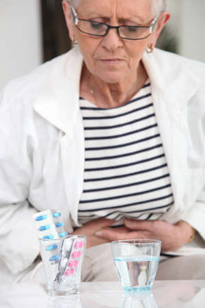 Woman about to take pain relievers photo