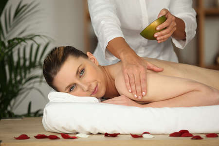 Woman receiving massage photo