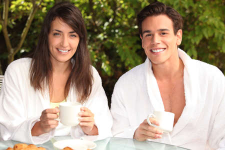 Couple having breakfast outside photo