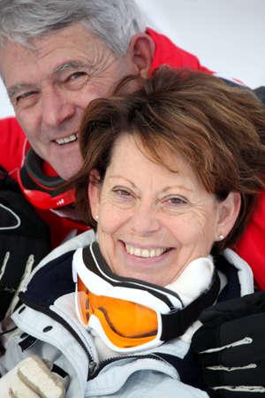 Elderly couple skiing photo