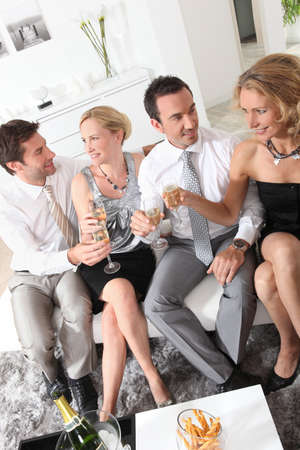 Friends drinking champagne photo