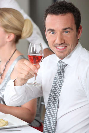 portrait of a man toasting photo
