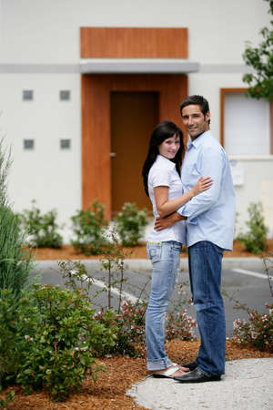 Young couple in front of apartments photo
