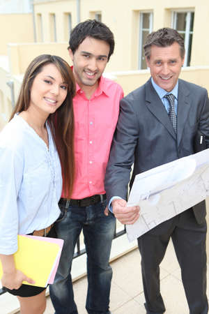 young couple having their own house built photo