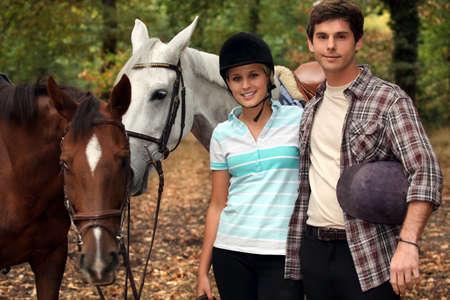 horseback riding: Horseback riders with their horses