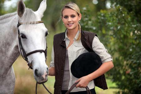 fair hair: Woman with horse