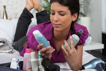 Woman laying with cosmetic products photo
