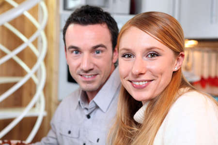 Smiling couple at home photo