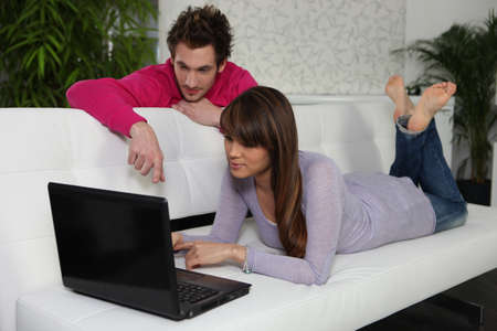 Man and woman in front of a laptop computer photo