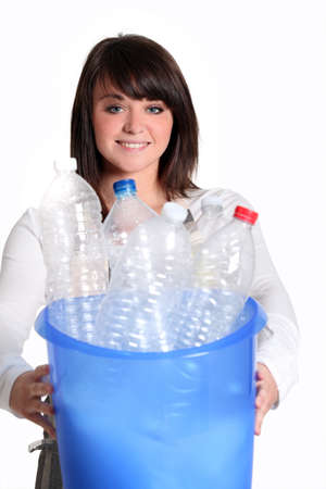 Young woman recycling bottles photo