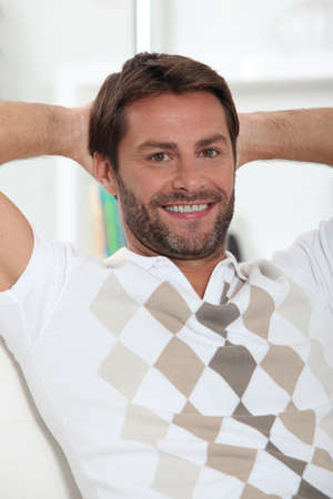 Man alone at home relaxing Stock Photo - 11610551
