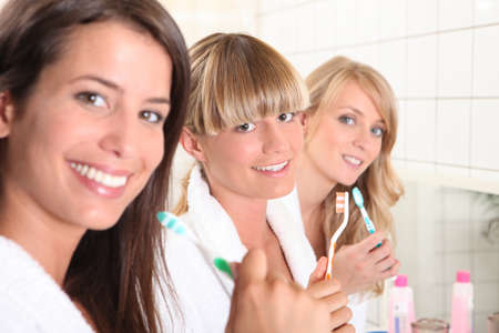 sleepover: Young woman in the bathroom together Stock Photo