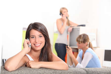 Friends using phones at home Stock Photo - 11610293