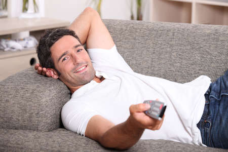 Man with remote control photo