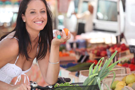 Brunette buying fruit and vegetables at local market Stock Photo - 11610506