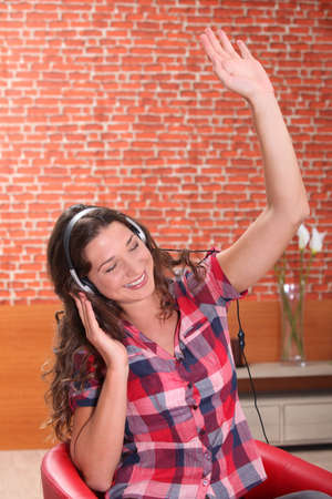 young woman listening and enjoying music photo