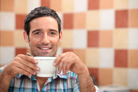 espresso machine: Man enjoying cup of coffee