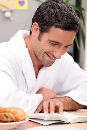 sanitarium: smiling man in robe reading