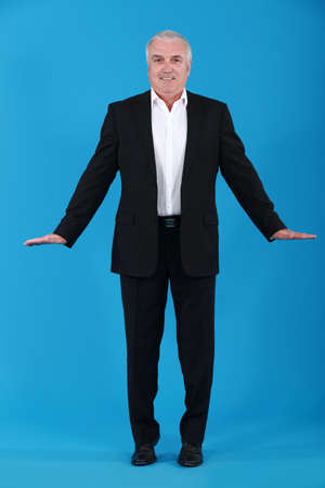 Businessman standing on tiptoes photo