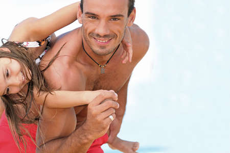 suntanned: Father and daughter and the beach together