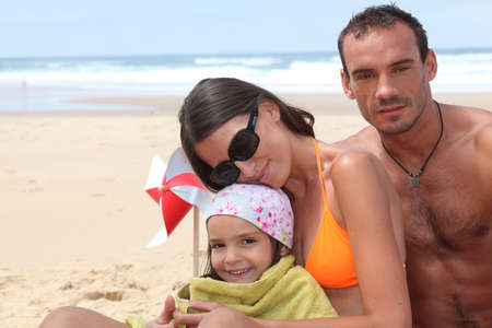 couple with their little girl on the beach Stock Photo - 11613024