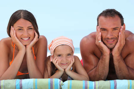 Portrait of a lovely family at the beach photo