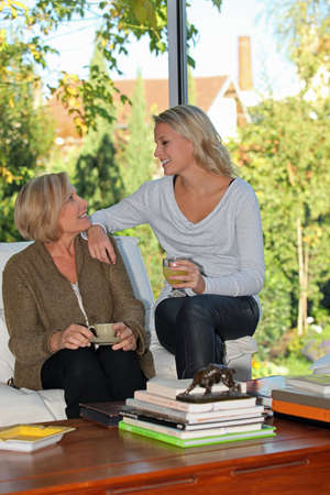 Mother and daughter chatting at home