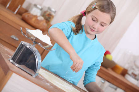 little girl making pancakes photo