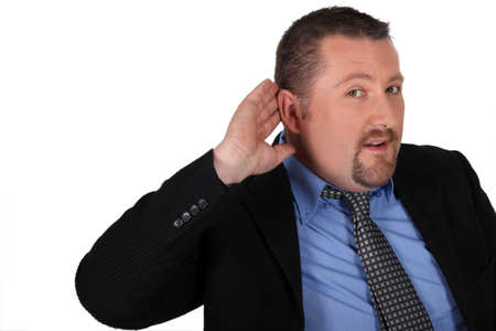 Businessman with his hand to his ear photo