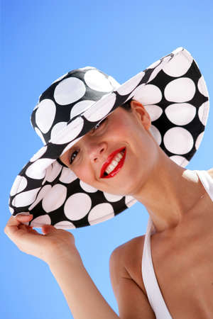 Sophisticated woman with hat photo