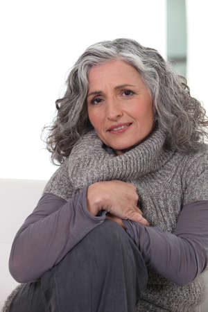 50 55: Portrait of a woman wearing  gray clothing Stock Photo