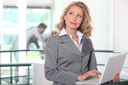 businesswoman at workplace with laptop Stock Photo - 11613174