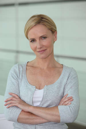 40s: Portrait of confident blond woman Stock Photo