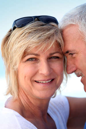 boomer: Middle-aged couple at the beach Stock Photo