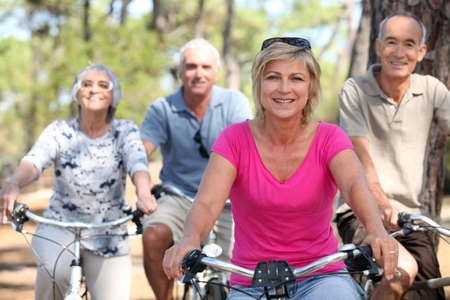 younger: seniors riding bicycles in the park