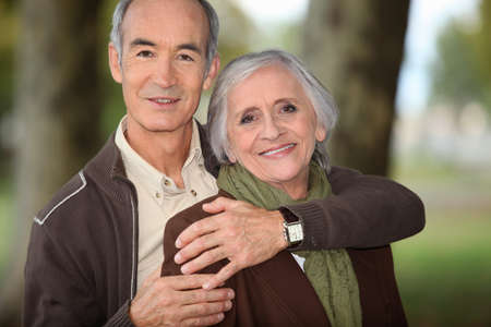 grandfather and grandmother: couple of grandparents embracing Stock Photo