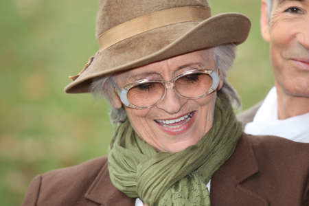 octogenarian: Old lady in a park Stock Photo