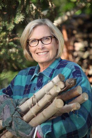 field glass: Woman gathering wood